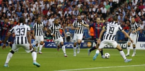 Barcelona's Andres Iniesta dances through the Juve area before pulling the ball back to Ivan Rakitic ...