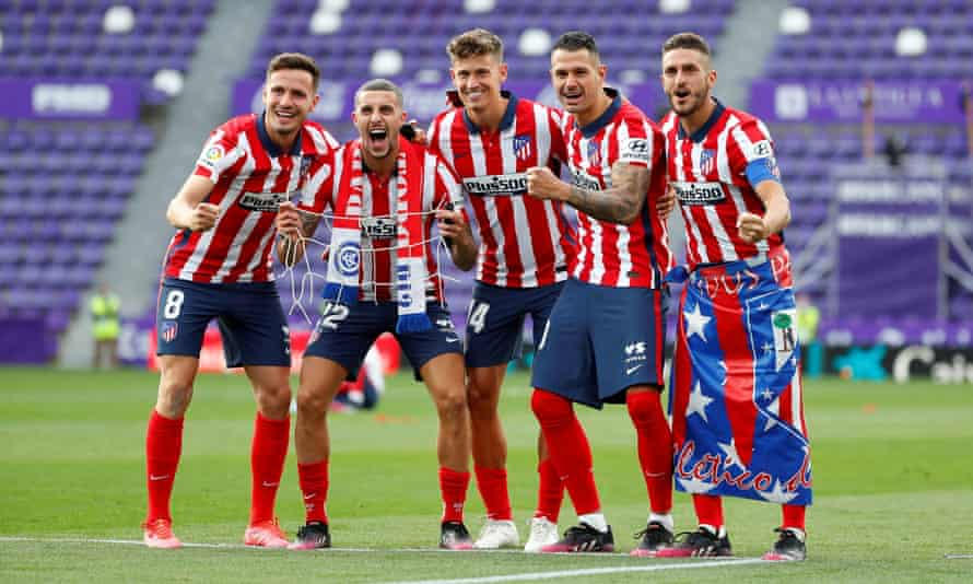 Koke (furthest right), wore the same flag in which he celebrated Atlético's previous 2014 title win.