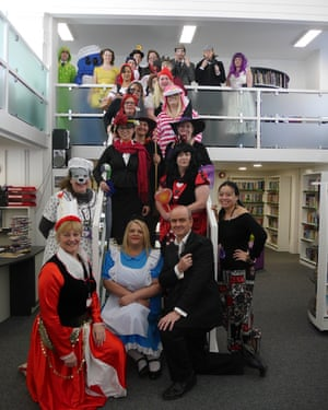 Stairway to Reading Heaven. School Staff at Hele's School in Plymouth engaged in World Book Day fun. Students are guessing Who's Who today.