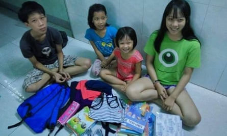 The children of Tran Thi Thanh Loan, pictured with their new school purchases made from funds provided by a crowd fund in Australia.