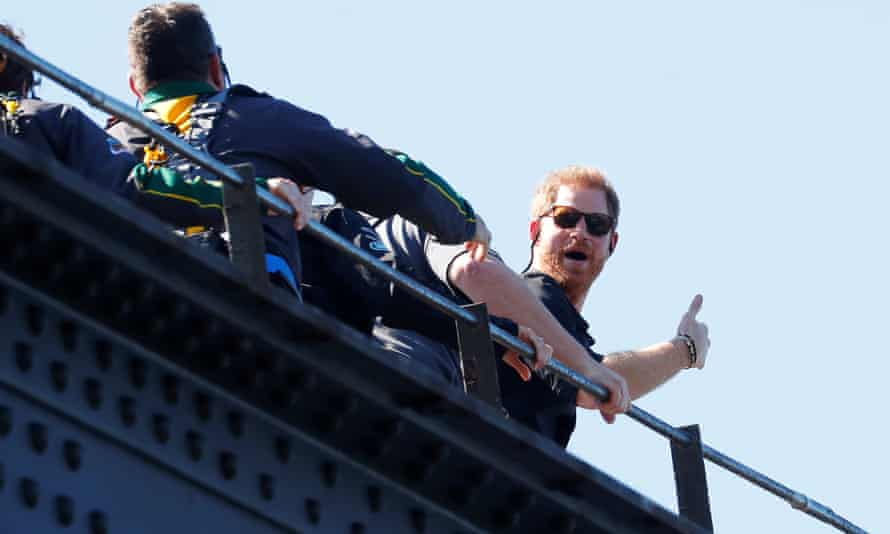 Prince Harry gives a thumbs-up as he climbs the Sydney Harbour Bridge.