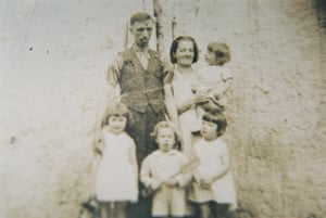 Barney Duffy and his wife Molly in the tenements, 1937, with the beginning of their family which today stretches around the world.