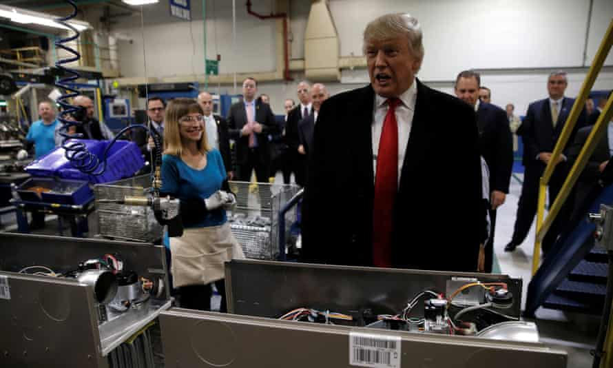 Donald Trump on a factory tour. Under the new deal, Carrier will keep 1,100 jobs at the Indianapolis plant rather than shifting them to Mexico.