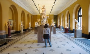 A visitor views an exhibit at the V&A museum.