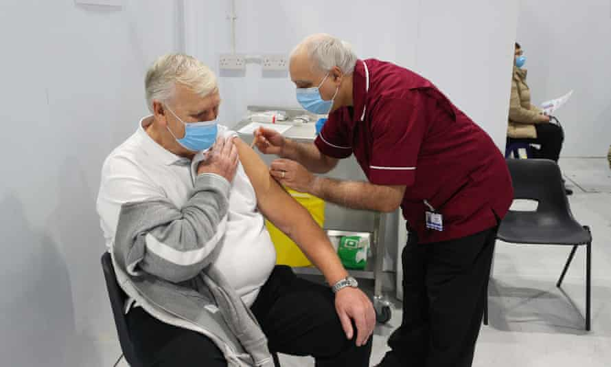 Man is injected with the coronavirus vaccine at a clinic in Blackpool.