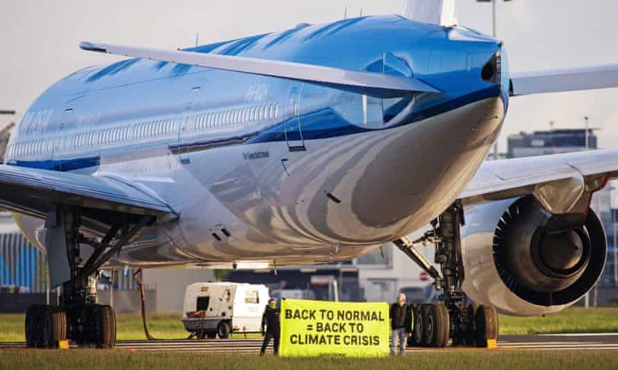 Greenpeace activists hold protest on Amsterdam airport runway on 14 May.
