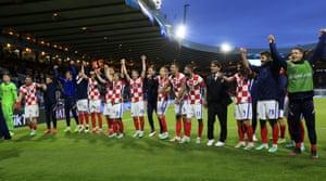 Croatia's team celebrates after winning the Euro 2020 game against Scotland.
