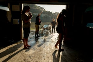 Members of the Union Boat Club rowing team clean their boats after a training session