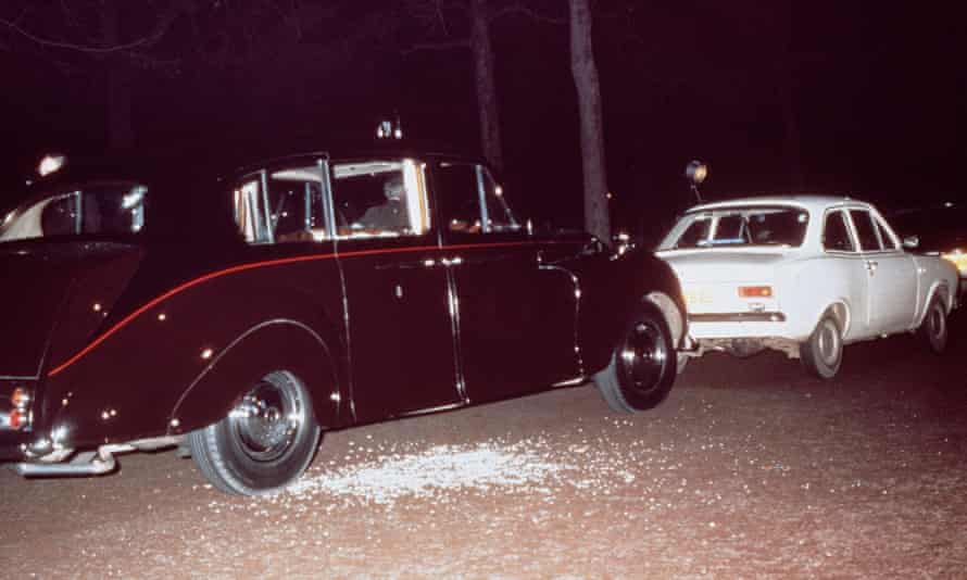 Ian Ball's white Ford Escort blocking the path of the Princess's Rolls Royce limousine, May 1974.