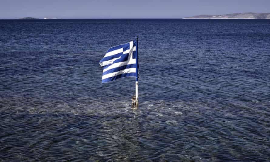 a greek flag in the sea