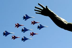 Russian Su-27 and MIG 29 jet fighters fly over Red Square, Moscow