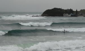 Surfers ride large waves at Terrigal Beach on the central coast of New South Wales.