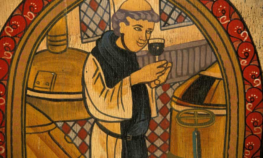 Monk gets set to take a tipple of beer made at a Trappist monastery.
