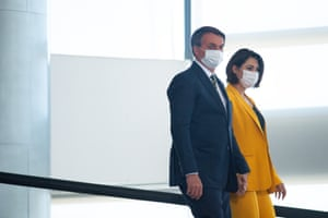 President of Brazil Jair Bolsonaro and wife first lady Michelle Bolsonaro arrive for a celebration of National Volunteer Day amidst the coronavirus pandemic at the Planalto Palace on 28 August, 2020 in the capital Brasilia.