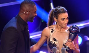 Marta collects her award for best Fifa women's player of 2018 from host Idris Elba.