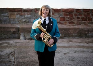 Barbara Middleton with her tenor horn in Watchet, Somerset.