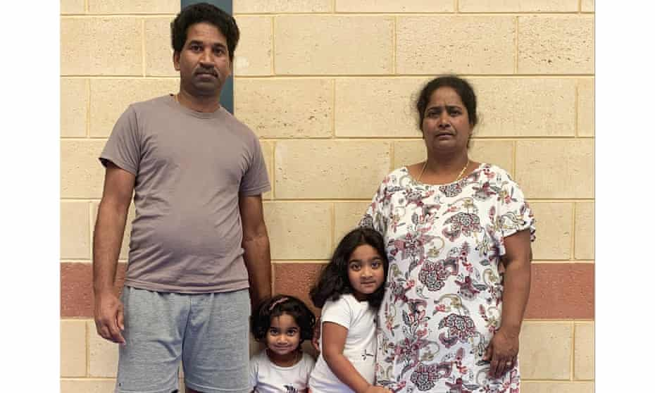 Nades (father) and Priya Murugappan (mother) with their children Kopika (right) and Tharunicaa (left).