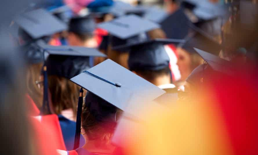 Students at a graduation ceremony. Australia is now ranked 24th out of 25 advanced economies for public spending on higher education as a share of gross domestic product.