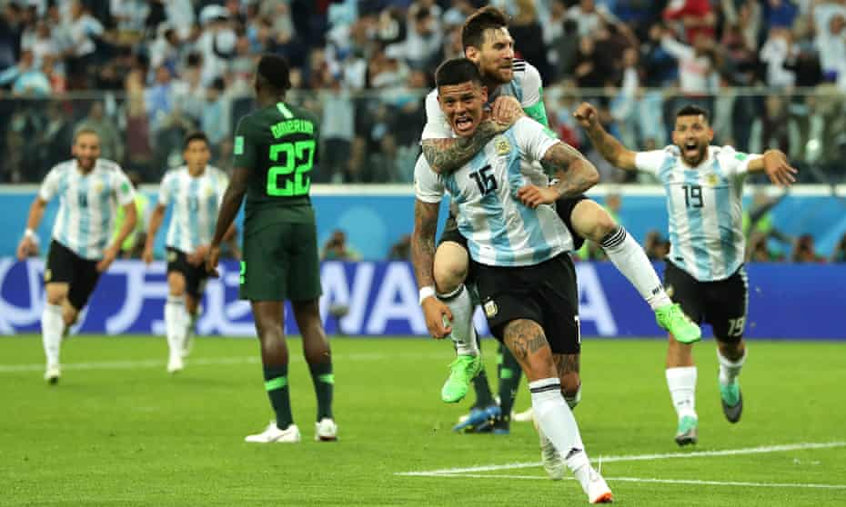 Marcos Rojo celebrates his late goal with Lionel Messi.