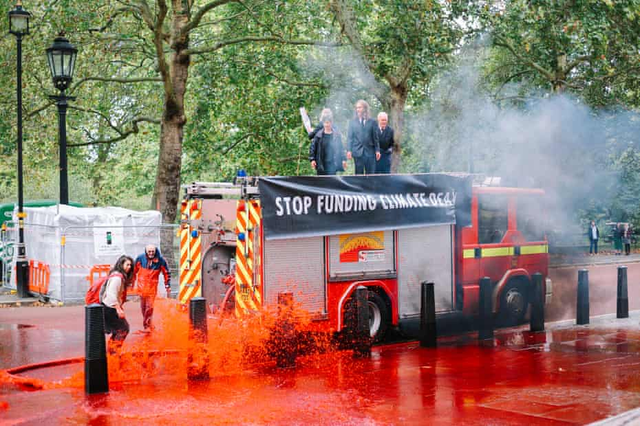 XR activists used an out of commission fire engine to spray fake blood at the Treasury
