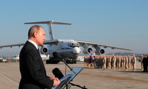 Vladimir Putin addresses Russian troops at an air base in Syria in December 2017.
