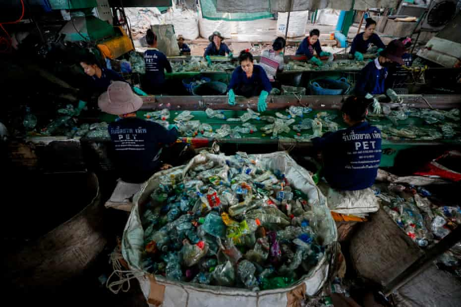 Migrant workers sort through plastic bottles at the Thaiplastic Recycle Group plant in Samut Sakhon, outside Bangkok, Thailand.