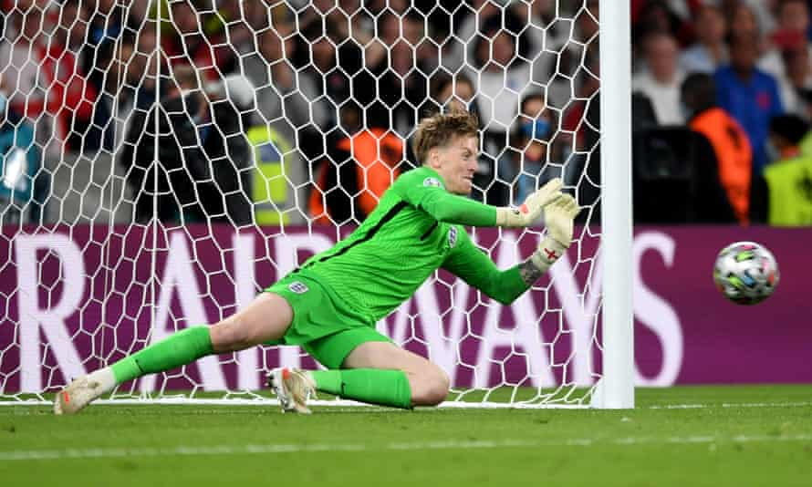 England goalkeeper Jordan Pickford saves the penalty taken by Italy's Andrea Belotti during the shootout at the end of the Euro 2020 final at Wembley.