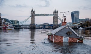 A model house launched by Extinction Rebellion activists floats in the Thames by Tower Bridge, Sunday 10 November.