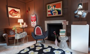 Wood-panelled front room with shark chair, fried-egg rug, pop art pictures and ''Venessa Bell is an Idiot'' artwork.