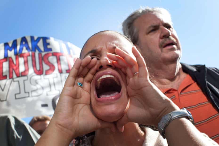 Nicole Collazo-Santiago leads a chant outside the Goldman Sachs building.