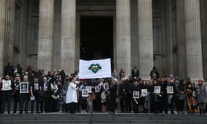 A banner is held up at the Grenfell Tower National Memorial Service at St Paul's cathedral on December 14, 2017 in London, England.