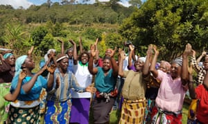 A tree-planting group close to Mount Kenya sings together