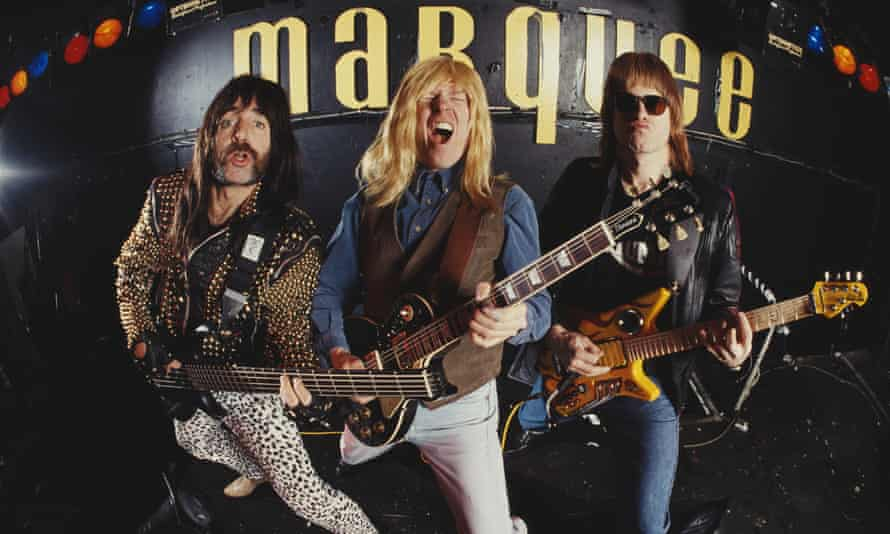 Heavy metal group Spinal Tap pose at the Marquee, 1992. Pictured are, from left, Derek Smalls (as played by actor Harry Shearer), David St Hubbins (as played by actor Michael McKean), and Nigel Tufnel (as played by actor Christopher Guest). (Photo by Tony Mottram/Getty Images)