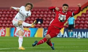 Liverpool's Ozan Kabak blocks a shot by Real Madrid's Luka Modric.