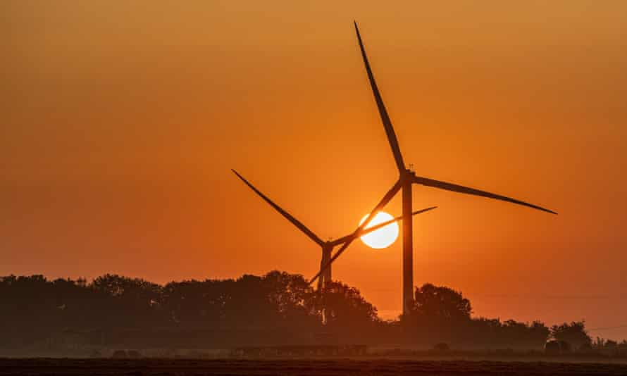 Morning sunrise in North Yorkshire with wind turbines and trees
