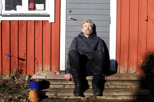 Knausgaard outside his home in Sweden.