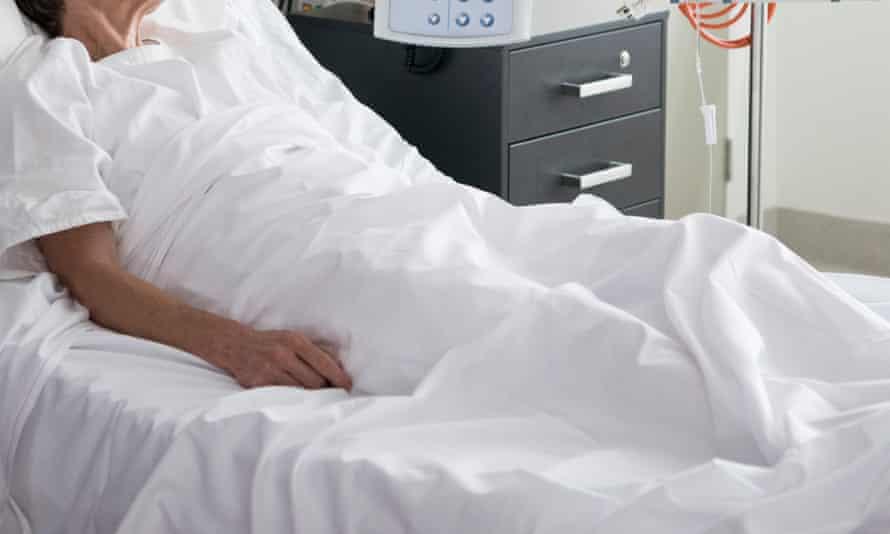 Australia women in hospital bed