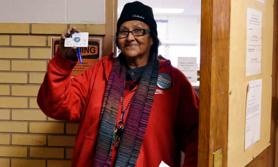 Alva Gabe, who has lived in Standing Rock her whole life and voted in every election since 1984, shows her new tribal ID with a street address, which will allow her to vote in North Dakota.