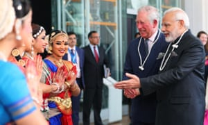Prince Charles and the prime minister of India, Narendra Modi, speak to dancers during their visit to the Science Museum.