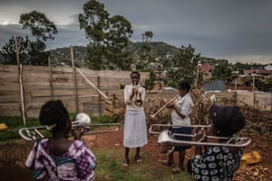 Sarah Kavuo, 15, plays the trumpet in a church yard in the town of Beni in Eastern Democratic Republic of Congo, along with her sister Milka Kavuo, 14 (2ndR), Esther Kahindu, 16, (R), and Nema Kavira, 16