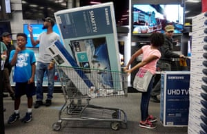 Shoppers buy electronic items at a Best Buy in San Diego, US