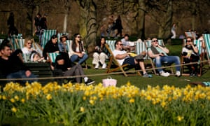 People relax on deck chairs in Hyde park in London, England, as lockdown restrictions were eased.