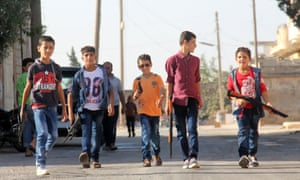 Boys playing with toy guns in the suburbs of Idlib