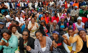 People sit in rows at the anti-Mugabe rally in Harare