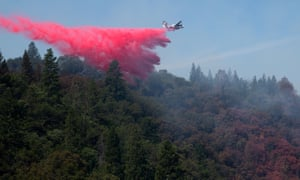 A plane drops fire retardant over the Jones fire on Monday, outside Nevada City, California.
