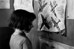 A girl from the Canning Town Women's Settlement in 1940, looking at some of the work produced by local children expressing their view of the second world war. Shot by Gerti Deutsch, who was brought up in Austria and worked mainly for Picture Post.