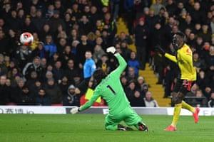 Ismaïla Sarr dinks a fine finish over Alisson to double Watford's advantage.