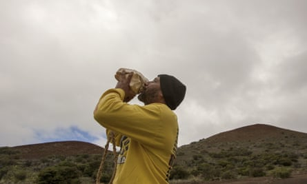 Kupono Mele-Ana-Kekua blows a conch shell near the summit of Mauna Kea on Hawaii's Big Island. Hawaiian conservationists say they'll continue to fight the Thirty Meter Telescope project slated for the mountain which won approval in supreme court this week.