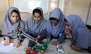 Afghan school girls test robot vehicles at a school in Herat. Six Afghan teenage girls have been denied visas to travel to the United States for an international robotics competition.