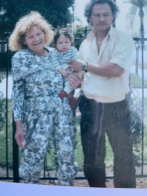 Escobar Mejia with his mother, left.